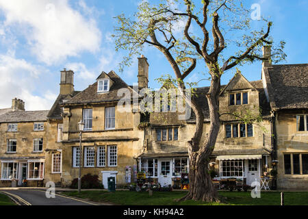 Cotswold stone buildings and shops in historic Cotswolds AONB village. High Street, Chipping Campden, Gloucestershire, - Stock Photo