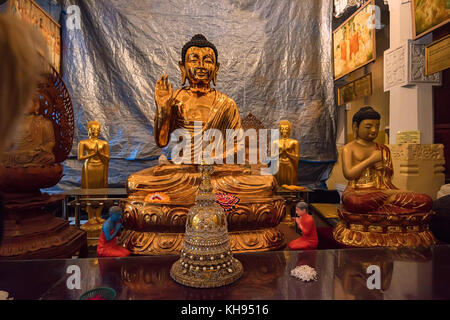 Buddha statues in Temple of the Tooth - Stock Photo