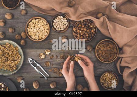person cracking walnut - Stock Photo