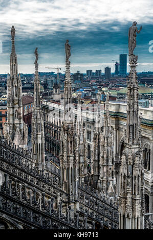 Italy. Lombardy. Milan Cathedral, Duomo di Milano, one of the largest churches in the world. Spires of the Duomo - Stock Photo
