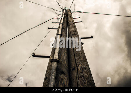 Serbia - Double electric pole with lightning rod against the stormy sky - Stock Photo