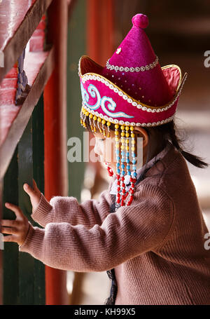 Qilian,China - October 16,2017: Little girl visits the caves of Matisi on October 16, China. - Stock Photo