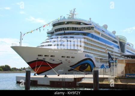 JULY 5, 2016: Cruise ship AIDAdiva at the cruise ship terminal in Rostock-Warnemuende, Germany - Stock Photo
