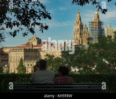 SANTIAGO DE COMPOSTELA, SPAIN, AUGUST 2016 - A couple of tourists takes pictures of the cathedral of Santiago de - Stock Photo