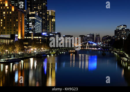 Southbank Precinct and Evan Walker Bridge on Yarra River by night - Melbourne, Victoria, Australia - Stock Photo