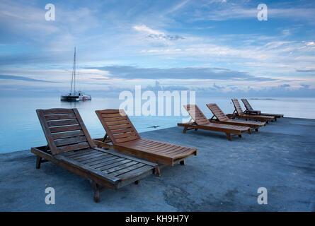 ... Deck Chairs On Jetty Near Ocho Rios, Jamaica, Caribbean, West Indies    Stock