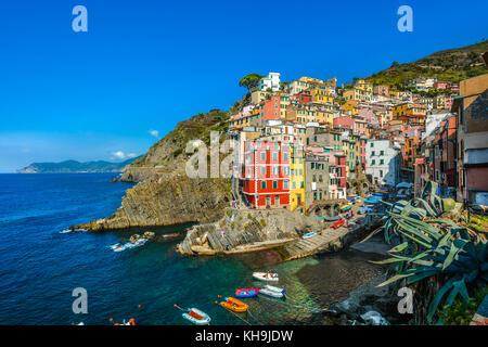 The colorful coastal village of Riomaggiore, one of the five coastal towns on the Cinque Terre on the Ligurian coast - Stock Photo