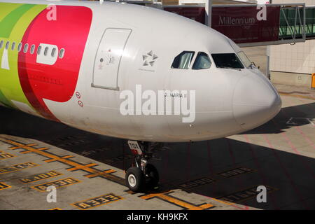 A TAP Airbus A330 CS-TOX passenger plane at the gate at Lisbon Airport, Portugal - Stock Photo