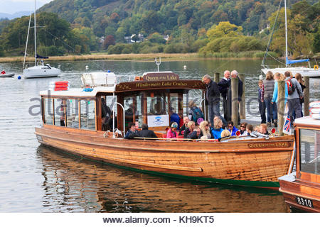 Tourists boarding the Queen of the Lake on Windermere . Waterhead near Ambleside Cumbria England UK - Stock Photo