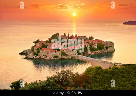 Sunset time at Sveti Stefan Island near Budva, Montenegro - Stock Photo