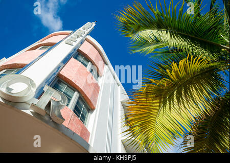 MIAMI - August 31, 2017:  Miami Beach's iconic art-deco architecture of Tudor Hotel and palm trees on Collins Ave. - Stock Photo