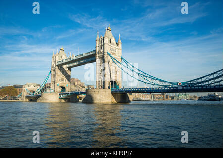 Scenic landscape view of Tower Bridge standing tall in afternoon light above the River Thames as viewd from the - Stock Photo