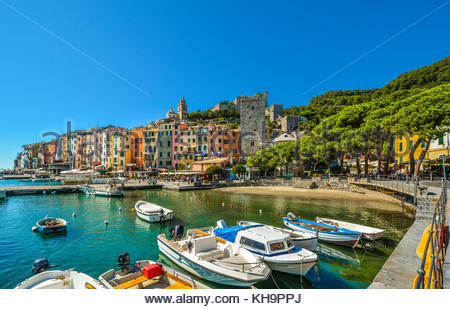 The colorful beach and village of the seaside city of Porto Venere on the Ligurian coast of Northern Italy, an Unesco - Stock Photo