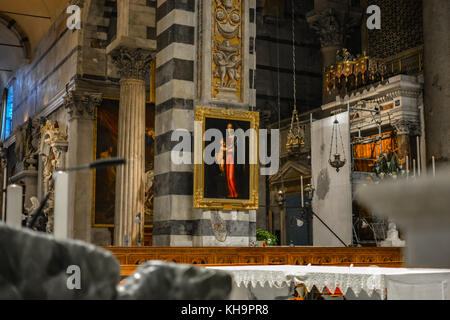 Interior of the Pisa Cathedral in the Tuscany region of Italy showing a renaissance painting of the Virgin Mary - Stock Photo