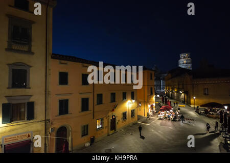 Late night photograph from Pisa Italy showing the leaning tower of Pisa illuminated in the distance over an empty - Stock Photo