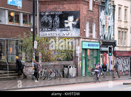A Banksy artwork entitled The Mild Mild West stenciled on the side of a building in Stokes Croft, Bristol - Stock Photo