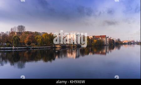 Riverside of Kreuzberg, along the Spree, early morning in autumn. - Stock Photo