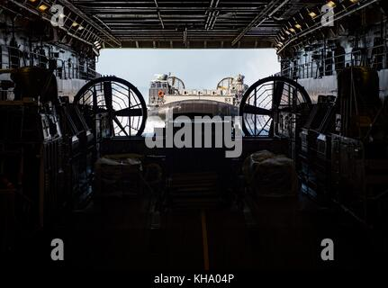 Landing Craft, Air Cushion prepares to enter the well deck of the amphibious transport dock ship U - Stock Photo