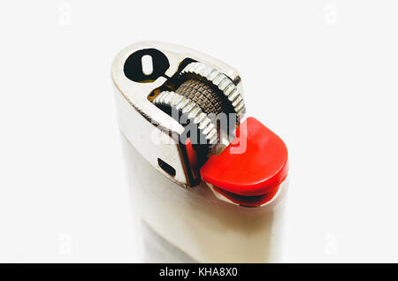 Close up on a used white lighter with red button. No fire. - Stock Photo