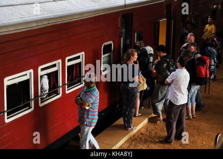 Peradeniya Junction Station Kandy Central Province Sri Lanka Passengers Boarding train - Stock Photo