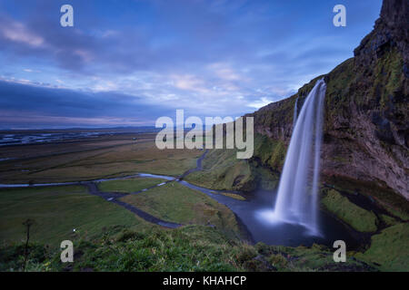 Seljalandsfoss waterfall on the south coast of Iceland. A well known tourist destination. - Stock Photo