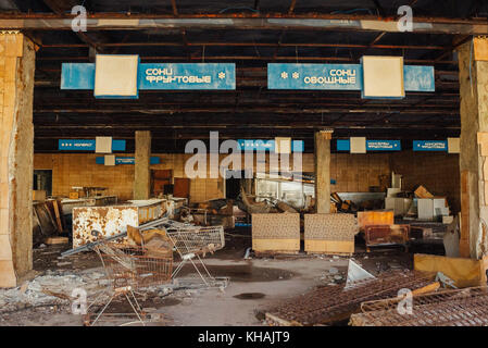 An abandoned supermarket complete with shopping trollies in the model Soviet town of Pripyat, as seen 30 years after - Stock Photo