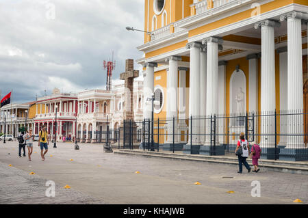 Granada, Nicaragua - July 22, 2015:  Tourists and local people walk past the Cathedral of Our Lady of the Assumption - Stock Photo