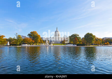 Capitol Hill panorama with reflection pool in late autumn, Washington DC, USA. US Capitol in fall on a cold sunny - Stock Photo