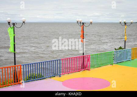 Colorful pier by the shore of Lake Managua, aka Lago Xolotlan, by the capital of Nicaragua. Central America - Stock Photo