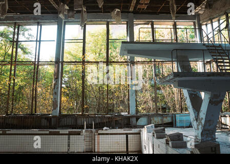 The old swimming pool hall in Pripyat, Ukraine, close to the location of the Chernobyl disaster - Stock Photo