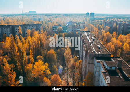 view from a rooftop looking down over the former postcard, idealised Soviet village of Pripyat, where many Chernobyl - Stock Photo