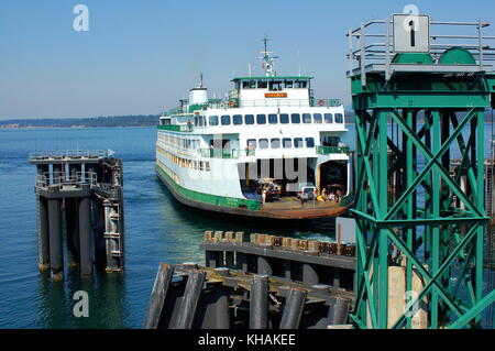 Ferry boat docking Friday Harbor in the San Juan Islands. - Stock Photo