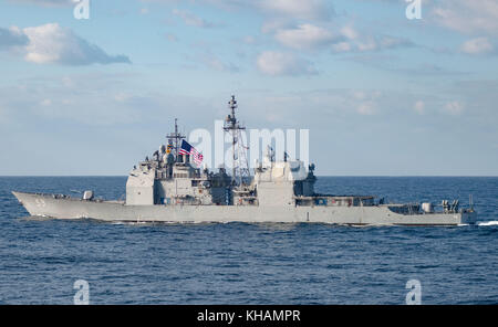 The Ticonderoga-class guided-missile cruiser USS Princeton (CG 59) participates in a photo exercis - Stock Photo