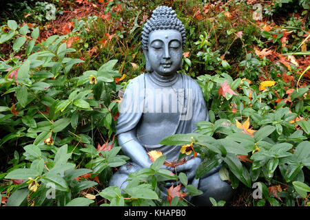 A Buddha statue at autumn garden in Kyoto, Japan Stock Photo ...