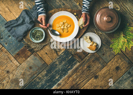 Fall warming pumpkin cream soup, copy space
