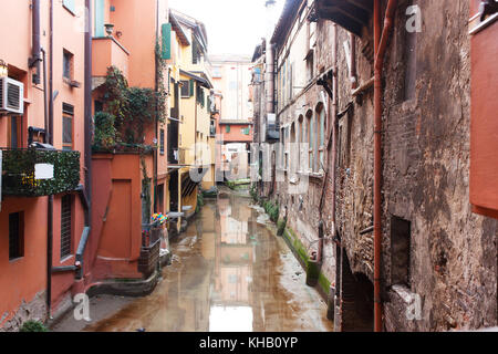 Old water canal hidden behind a window in Bologna  , Italy - Stock Photo