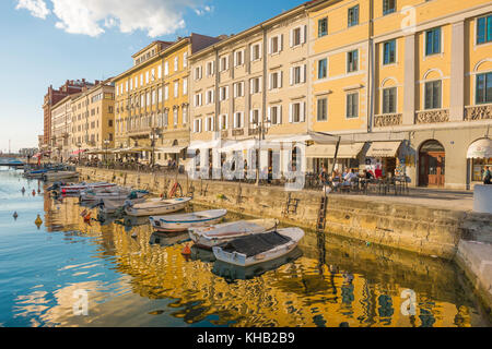Canal Grande Trieste, view of cafes and buildings lining the Canal Grande in the centre of Trieste, Italy. - Stock Photo