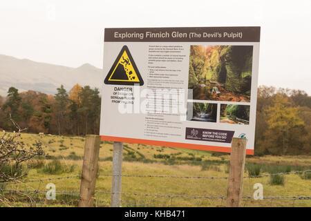 Finnich Glen (The Devil's Pulpit) safety information sign, Killearn, Stirlingshire, Scotland, UK - Stock Photo
