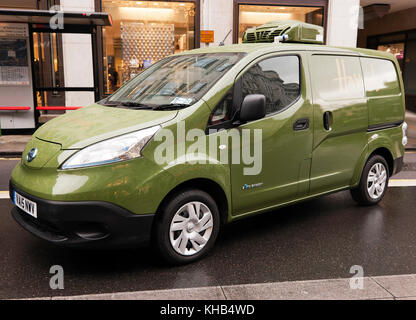 Three-quarter  front view of a  Harrods, Nissan e-NV200 electric delivery van on display  during the Regents Street - Stock Photo