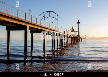 Sunset at Brighton beach, showing the concrete jetty which has abstract features. - Stock Photo