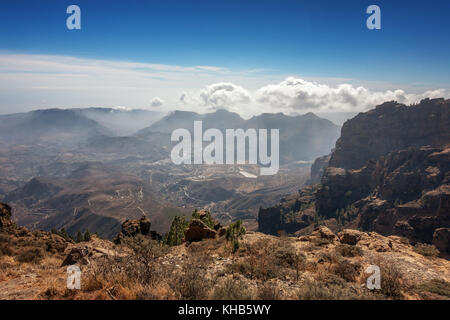 Mountain views inland from Pico de las Nieves mirador (the summit of Gran Canaria) down to San Bartolome, Canary - Stock Photo