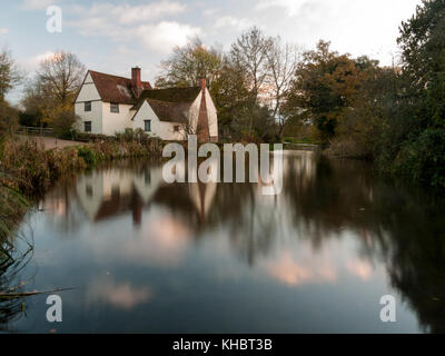 beautiful willy lotts cottage autumn long exposure blurred water constable country flatford mill; suffolk; england; - Stock Photo