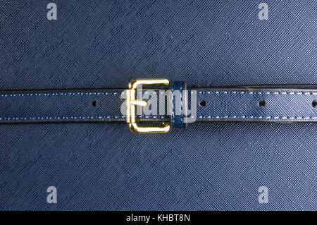 closeup of buckles, clasps, zippers, pockets, fasteners, fittings and seams on the blue hand bag - Stock Photo