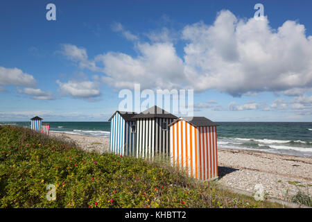 Colourful beach huts on pebble beach with blue sea and sky with clouds, Rageleje, Kattegat Coast, Zealand, Denmark, - Stock Photo