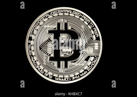 Symbol image digital currency, silver physical coin Bitcoin - Stock Photo