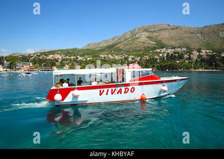 SREBRENO, CROATIA - JULY 18, 2017 : A tourist boat sailing in the Adriatic sea in Srebreno, Croatia. - Stock Photo
