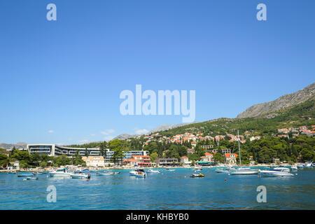 SREBRENO, CROATIA - JULY 18, 2017 : A view of boats anchored at seaside in front of Hotel Sheraton in Srebreno, - Stock Photo