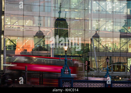 Old and new architecture with the Tower of London reflected in a modern glass office block, Tower Bridge House, - Stock Photo