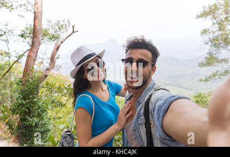 Couple With Backpacks Take Selfie Photo Over Mountain Landscape Trekking, Young Man And Woman On Hike Tourists - Stock Photo