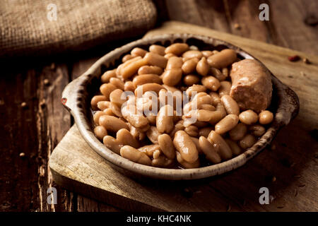 closeup of an earthenware bowl with a cassoulet de Castelnaudary, a typical bean stew from Occitanie, in France, - Stock Photo